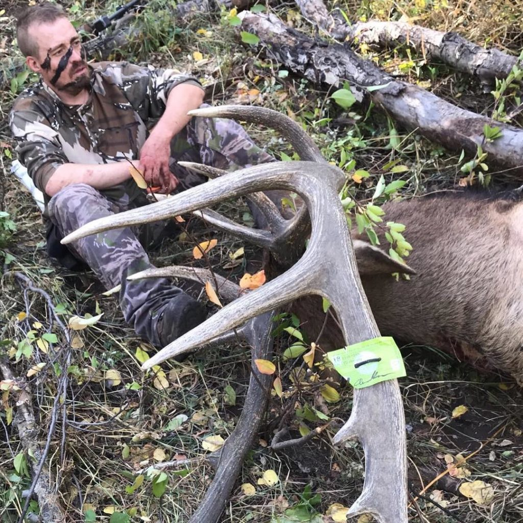 Owner Drew Rouse with huge bull elk
